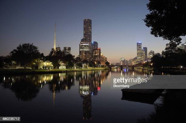 The Art Centre Spire left and other buildings' lights are reflected in the Yarra River in Melbourne Australia on Friday April 28 2017 Australia has...