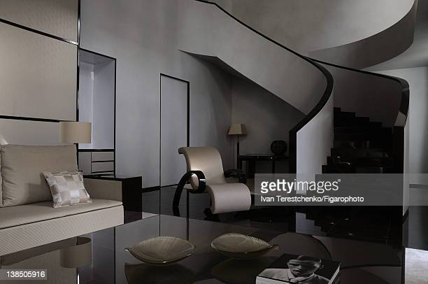 The Art Deco-style staircase in one of the suites in fashion designer Giorgio Armani's hotel, Armani Hotel, is photographed for Madame Figaro on...