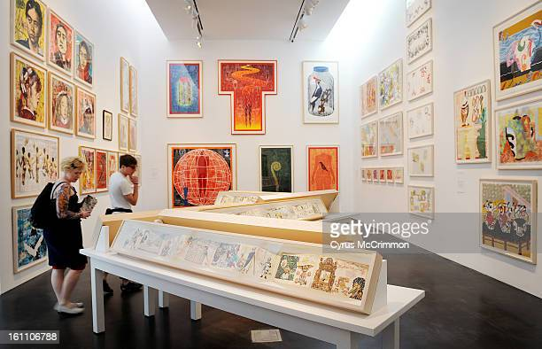 The art work climbs up the walls at Shark's Ink : The Legend of Bud Shark and his Indelible Ink exhibit at the Museum of Contemporary Art in Denver...