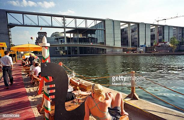 the artificial beach along the Spree at back of the Bundestag library in Berlin Germany