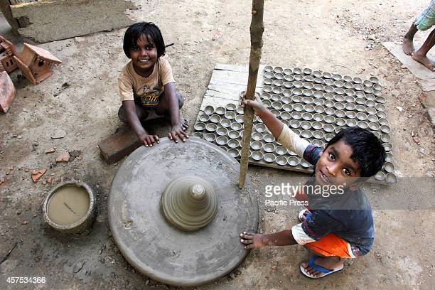 The artisans children sit on the ground The artisans children are obliged to carry forward the legacy learn the trade early instead of going to school