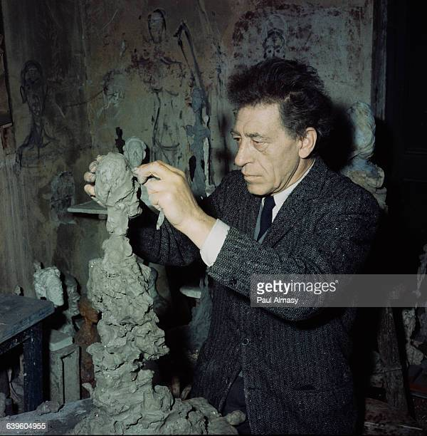 The artist Alberto Giacometti at work on a sculpture in his studio France 1958