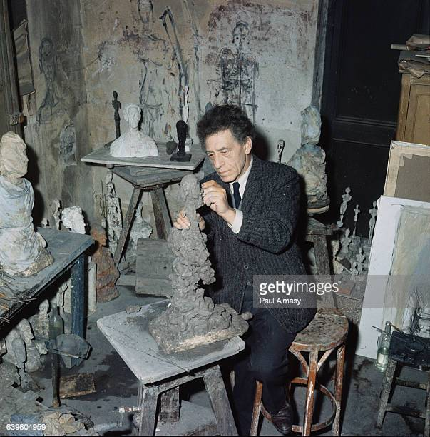 The artist Alberto Giacometti at work on a sculpture in his studio 1958