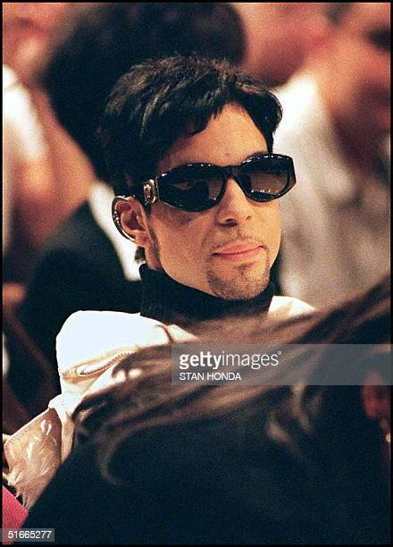 The artist formerly known as Prince watches the New York Knicks and Washington Bullets from a courtside seat 10 December in Madison Square Garden in...