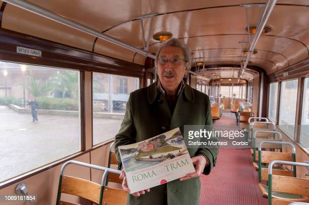 """The artist Franco Bevilacqua, photographed inside a vintage tram, author of the book of drawings collected in """"Rome from the Tram - The wonders that..."""