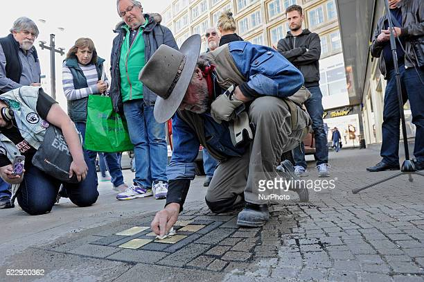 The artist Gunter Demnig pose the Stolpersteine in Berlin on April 21, 2016. The project commemorates people who were persecuted as 'asocial' by the...