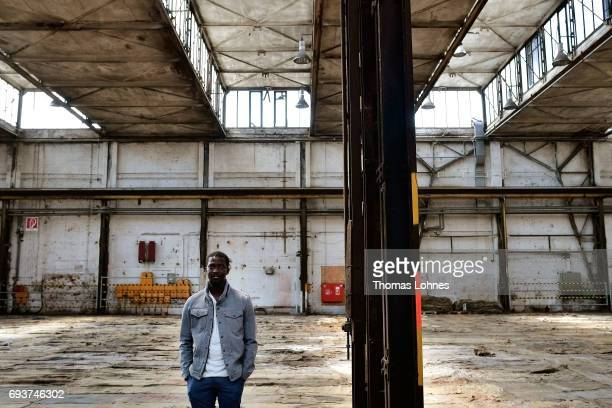 The artist Ibrahim Mahama of Ghana stands in the 'Henschel Hall' with jute bags for his next artwork on June 8 2017 in Kassel Germany The documenta...