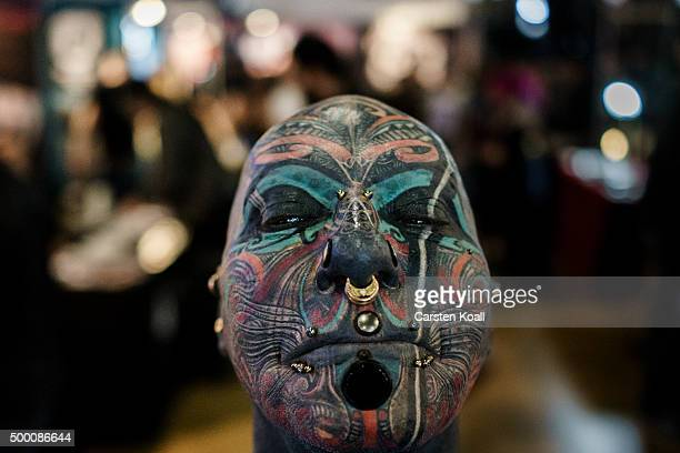 The artist Magneto shows his tattoos during a photo shoot at the Berlin Tattoo Festival on December 5 2015 in Berlin Germany