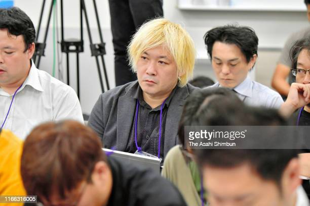 "The artistic director of exhibition ""After 'Freedom of Expression?'"" Daisuke Tsuda listens to the remarks by Aichi Prefecture Governor Hideaki Omura..."