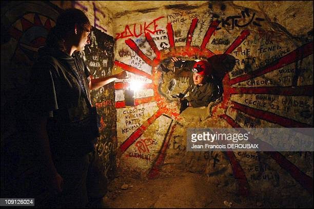 The Artists Of The Paris Catacombs On November 1 2004 In Paris France Chatiere Of The Painted Room