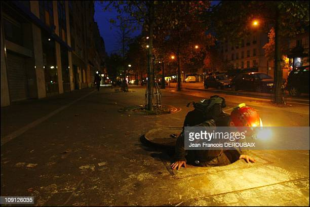 The Artists Of The Paris Catacombs On November 1 2004 In Paris France Leaving The Catacombs Via A Manhole In The Wee Hours Of The Morning