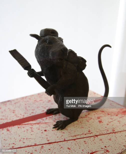 The artist's work 'Bronze Rat' on display at a press preview for the exhibition Banksy: The Unauthorised Retrospective, curated by Steve Lazarides,...