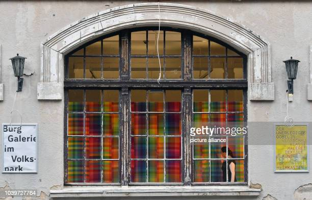 The artowrk 'Farbraum' by Margarita Wenzel can be seen through a window of the gallery of the Giebichenstein Castle art college in Halle/Salle...