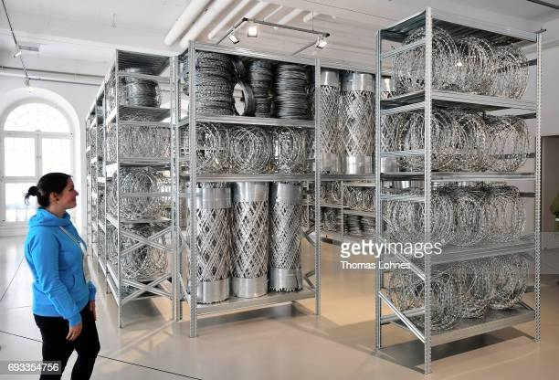 The artwork 'Acropolis Redux ' by Kendel Geers is made of fencing and steel shelves pictured on June 7 2017 in Kassel Germany The documenta 14 is the...