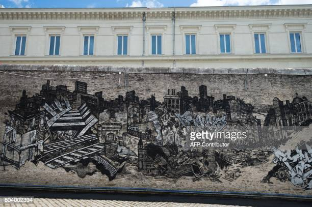 The artwork 'Entrez libre' by Pick Up Production is displayed on a wall of the former prison of Nantes on June 29 2017 during the 6th edition of the...