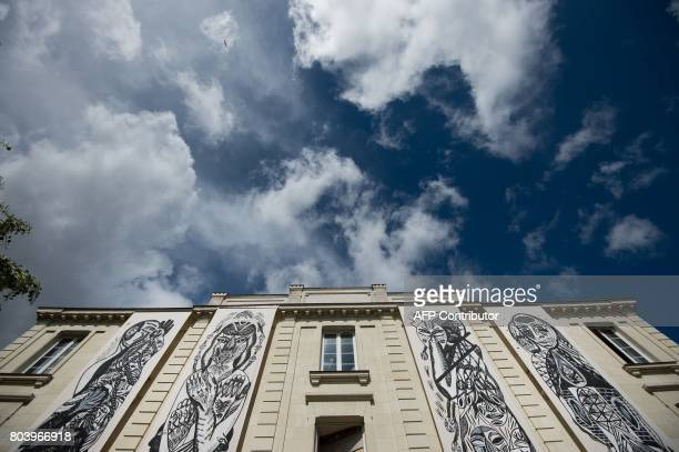 The artwork 'Entrez libre' by Pick Up Production is displayed on the facade of the former prison of Nantes on June 29 2017 during the 6th edition of...