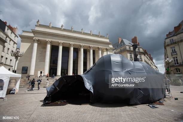 The artwork 'Hecate' by French artist Nicolas Darrot is pictured in Nantes western France on June 29 2017 during the 6th edition of the 'A journey to...