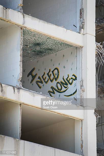The artwork of a past resident is exposed by a wrecking crew demolishing the last remaining highrise building from the infamous CabriniGreen housing...