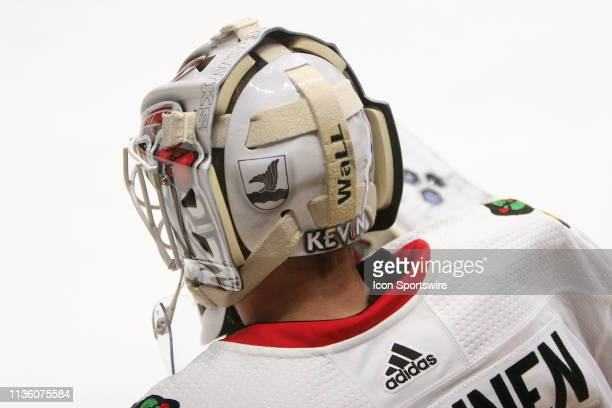 The artwork on the back of the mask of Chicago Blackhawks goalie Kevin Lankinen is shown prior to the NHL game between the Nashville Predators and...