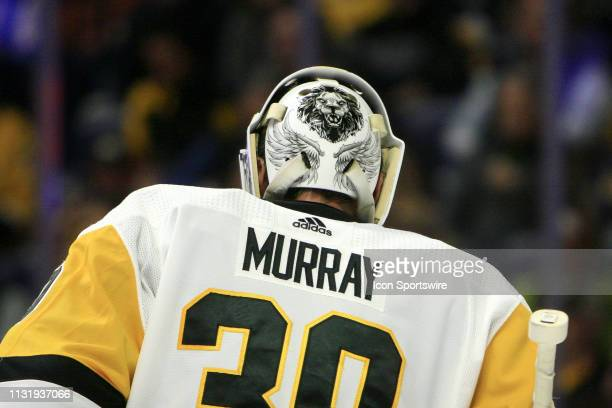 The artwork on the back of the mask of Pittsburgh Penguins goalie Matt Murray is shown during the NHL game between the Nashville Predators and...