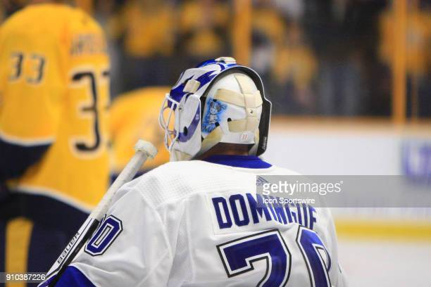 The artwork on the back of the mask of Tampa Bay Lightning goalie Louis Domingue is shown prior to the the NHL game between the Nashville Predators...
