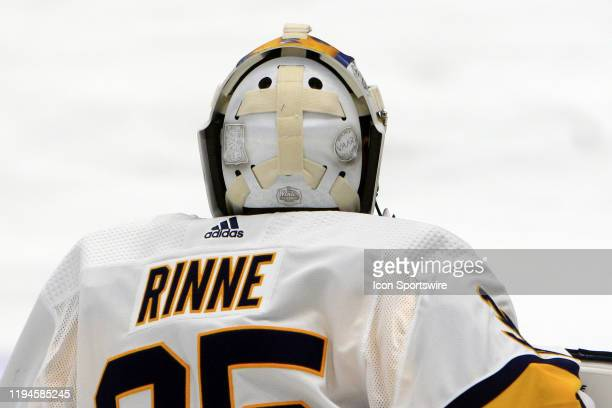 The artwork on the backplate of the Winter Classic mask of Nashville Predators goalie Pekka Rinne of Finland is shown prior to the NHL game between...
