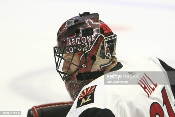 The artwork on the mask of Arizona Coyotes goalie Adin Hill is shown prior to the NHL game between the Nashville Predators and Arizona Coyotes held...
