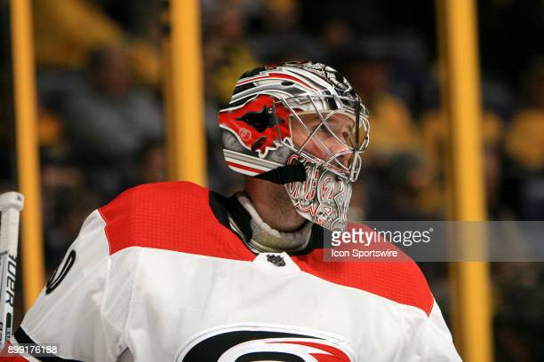 The artwork on the mask of Carolina Hurricanes goalie Cam Ward is shown during the NHL game between the Nashville Predators and the Carolina...