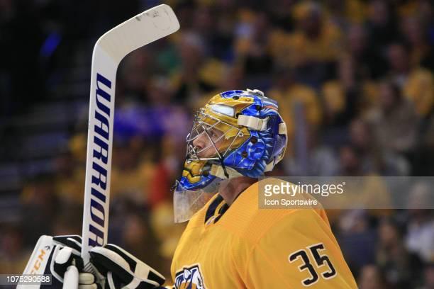 The artwork on the mask of Nashville Predators goalie Pekka Rinne is shown during the NHL game between the Nashville Predators and Dallas Stars held...