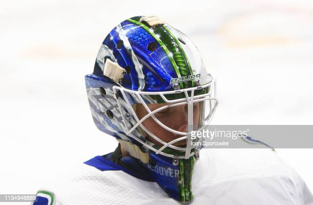 The artwork on the mask of Vancouver Canucks goalie Jacob Markstrom is shown prior to the NHL game between the Nashville Predators and Vancouver...