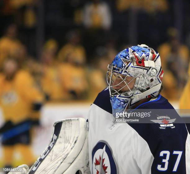 The artwork on the mask of Winnipeg Jets goalie Connor Hellebuyck is shown prior to the NHL game between the Nashville Predators and Winnipeg Jets...