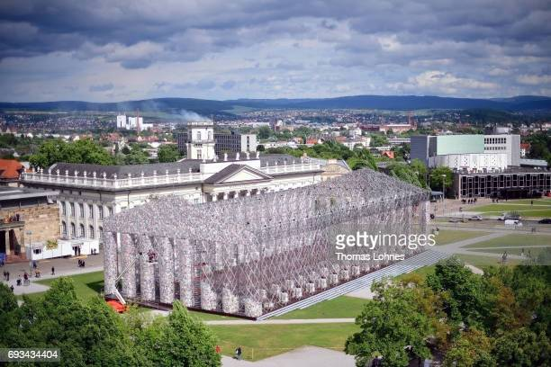 The artwork 'The Parthenon of Books' with donated books by the artist Marta Minujin the 'Kunsthalle Fridericianum' and the tower 'Zwehrenturm' with...