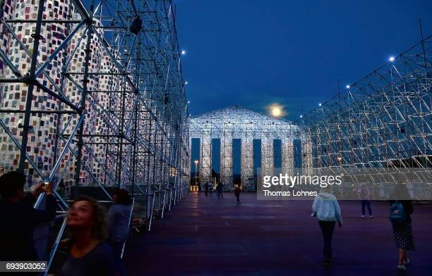 The artwork 'The Parthenon of Books' with donated books by the artist Marta Minujin is illuminated by light and the full moon on June 8 2017 in...