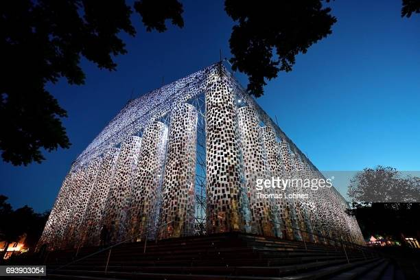 The artwork 'The Parthenon of Books' with donated books by the artist Marta Minujin is illuminated at night on June 8 2017 in Kassel Germany The...
