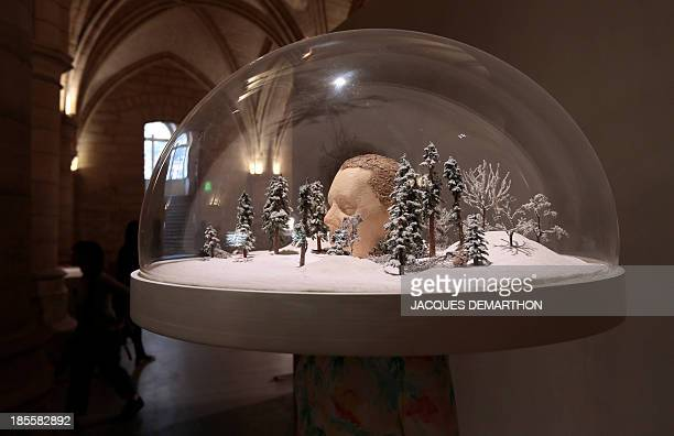 The artwork The Past is a Foreign Country by German artist Friedrich Kunath is displayed on October 22 2013 at the Conciergerie museum in Paris...