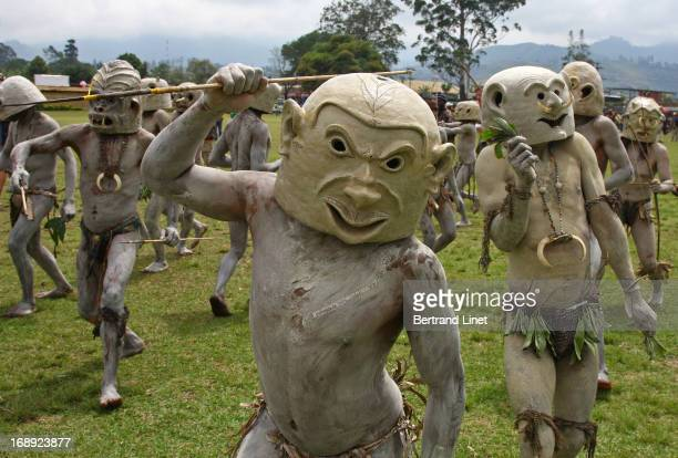 CONTENT] The Asaro Mudmen come from just outside the village of Goroka in the Eastern Highlands Province where there is every year one of the most...