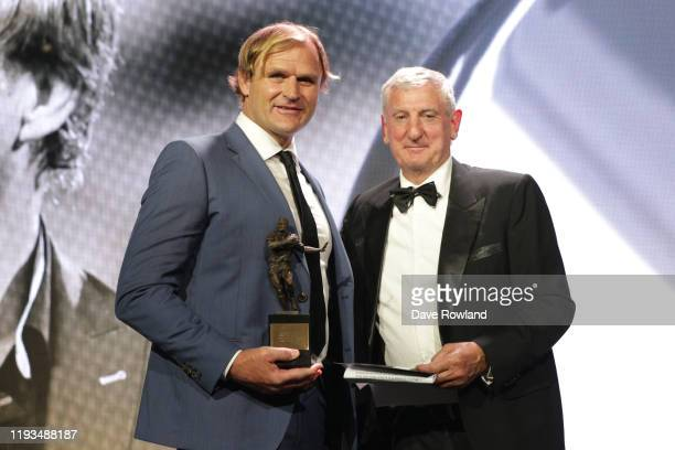 The ASB National Coach of the Year is Scott Robertson presented by Graham Mourie during the New Zealand Rugby Awards at the Sky City Convention...