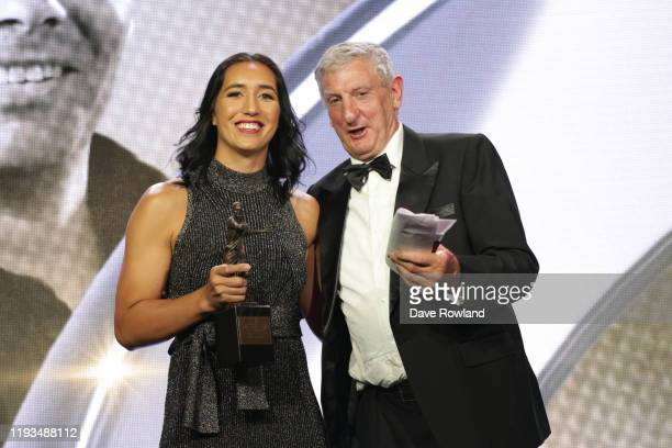 The ASB New Zealand Coach of the Year is Cory Sweeney and Allan Bunting collected by captain Sarah Hirini nee Goss from Graham Mourie during the New...