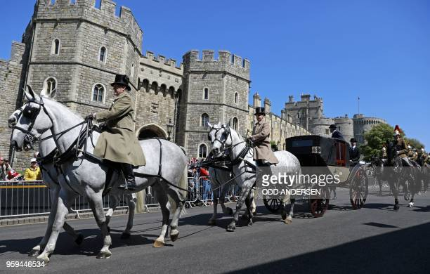 TOPSHOT The Ascot Landau carriage pulled by Windsor Grey horses is taken past the Henry VIII gate during a rehearsal for the wedding procession...