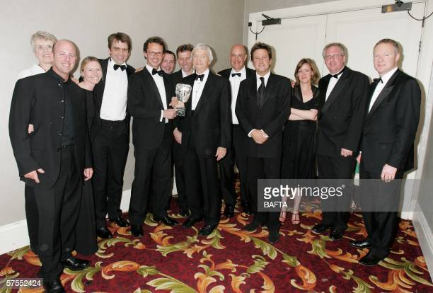 The Ashes Cricket England v Australia production team pose with Richie Benaud backstage after he was presented with a Special Award at the Pioneer...