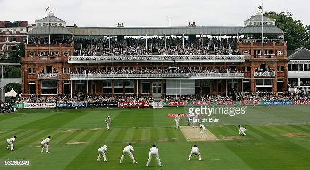 The Ashes get under way as Stephen Harmison of England bowls the first ball to Justin Langer of Australia during day one of the First Test between...