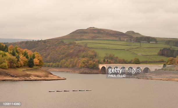 The Ashopton viaduct is seen over Ladybower reservoir in the Upper Derwent Valley in Derbyshire, northern England on November 6 as the colours of...