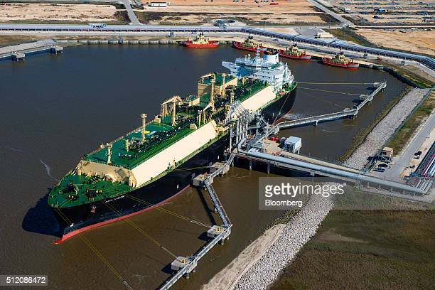 The Asia Vision LNG carrier ship sits docked at the Cheniere Energy Inc terminal in this aerial photograph taken over Sabine Pass Texas US on...