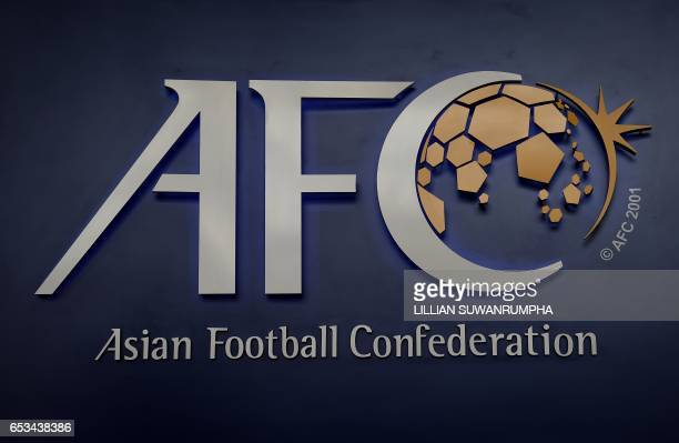 The Asian Football Confederation logo is displayed at the AFC headquarters in Kuala Lumpur on March 15 2017 The upcoming AFC Asian Cup qualifier...
