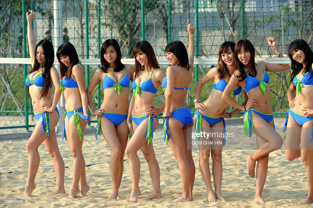The Asian Games Beach Volleyball Cheer Leaders Pose For A Photo Shoot During A Break In