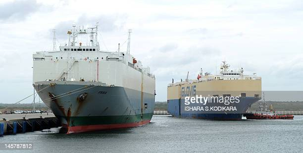 The Asian Sun car shipping carrier and and carrier Frisia are pictured at the main port of Sri Lanka's Chinesebuilt Hambantota port on June 6 2012...