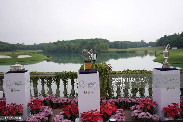 The AsiaPaific Amateur Golf Championship trophy and the US Master trophy and The Open trophy are displayed near the 9th hole during round one of the...