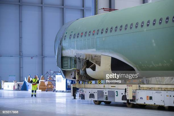 The assembled fuselage of an Airbus A320 narrowbody passenger twinengine jet airliner moves across the Airbus SE factory floor in Hamburg Germany on...