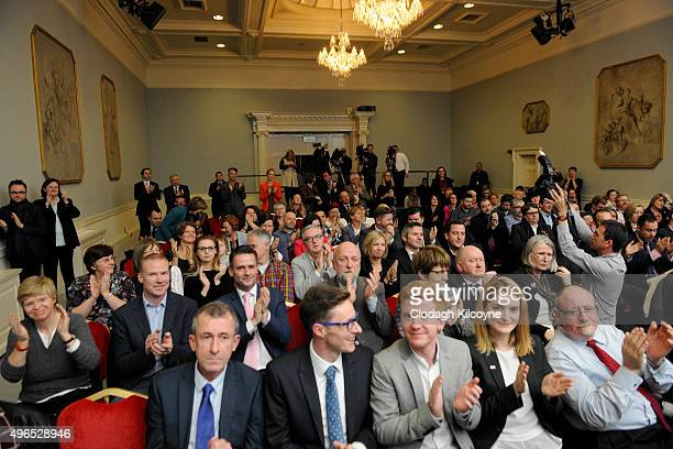 The assembled press and audience cheer as the Irish Minister for Justice and Equality Frances Fitzgerald signs the commencement order for the...
