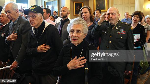 The assembled stand during the singing of the Star Spangled Banner during a Community Holocaust Commemoration of Yom Hashoah which was held at...